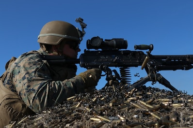 A U.S. Marine with Special Purpose Marine Air-Ground Task Force-Crisis Response-Africa 19.1, Marine Forces Europe and Africa, fires a M240B machine gun during Platinum Eagle 19.1, a multilateral training exercise held at Babadag Training Area, Romania, March 18, 2019
