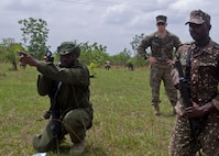 Members of the Ghanaian ministry of the interior conduct a patrolling exercise while a U.S. Marine with Special Purpose Marine Air-Ground Task Force-Crisis Response-Africa 19.1, Marine Forces Europe and Africa, supervises during a theater-security cooperation event in Asutsuare, Ghana, March 19, 2019.