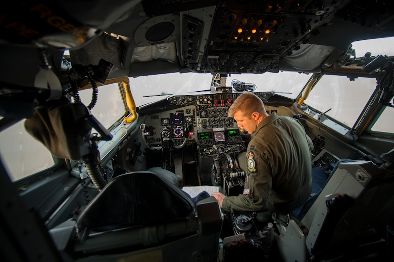 U.S. Air Force Capt. Brian Klazura, a 351st Air Refueling Squadron KC-135 Stratotanker pilot, reviews a pre-flight checklist during exercise African Lion 2019, April 2, 2019, at Moron Air Base, Spain. The crew supported U.S. and Royal Moroccan Air Force refueling training, which promoted interoperability and further developed tactics, techniques, and procedures of participating nations to counter-violent extremist organizations. (U.S. Air Force photo by Staff Sgt. Ceaira Tinsley)