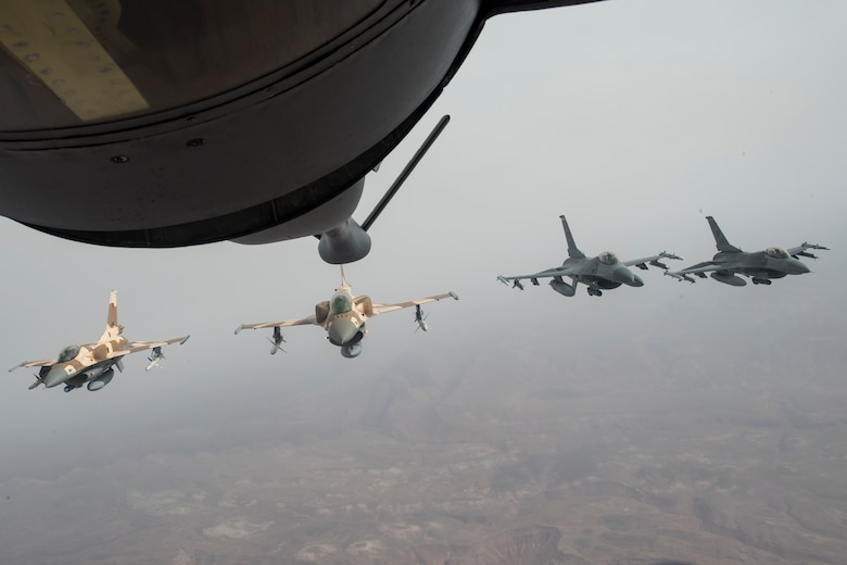 Two Royal Moroccan Air Force F-16s and two F-16C Fighting Falcons from the 555th Expeditionary Fighter Squadron fly over the skies of Morocco after receiving fuel from a U.S. Air Force KC-135 Stratotanker from the 100th Air Refueling Wing, RAF Mildenhall, England, during exercise African Lion 2019, April 2, 2019. The training was an example of U.S. Africa Command and U.S. Marine Corps Forces Europe and Africa's commitment to maintaining strong military relationships with our allies and partners. African Lion 2019 is an annual, combined multilateral exercises designed to improve interoperability and mutual understanding of each nation's tactics, techniques and procedures while demonstrating a strong partnership between nation's militaries. (U.S. Air Force photo by Staff Sgt. Ceaira Tinsley)
