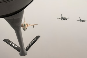A Royal Moroccan Air Force F-16 prepares to receive fuel from a U.S. Air Force KC-135 Stratotanker from the 100th Air Refueling Wing, RAF Mildenhall, England, during exercise African Lion 2019 over the skies of Morocco, April 2, 2019. African Lion 2019 is an annual, combined multilateral exercises designed to improve interoperability and mutual understanding of each nation's tactics, techniques and procedures while demonstrating a strong partnership between nation's militaries. (U.S. Air Force photo by Staff Sgt. Ceaira Tinsley)