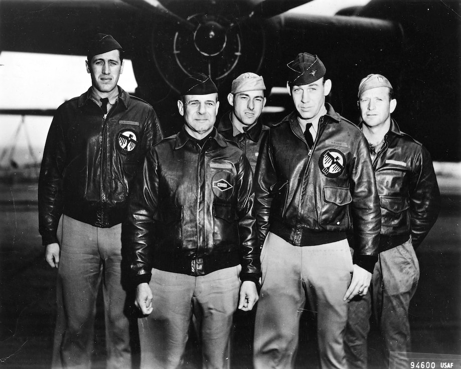 """(Left to right) Second Lt. Henry A. """"Hank"""" Potter, Lt. Col. James """"Jimmy"""" Harold Doolittle, Staff Sgt. Fred Anthony Braemer, 2nd Lt. Richard E. Cole and Staff Sgt. Paul John Leonard stand in front of a B-25 Mitchell bomber. (Courtesy photo from doolittleraider.com)"""