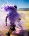 A Participant takes part in the fifth annual Colorful Consent Run on Marine Corps Air Ground Combat Center, Twentynine Palms, Calif,. April 5th, 2019. The 3.2 mile (5 kilometer) run took place in April, Sexual Assault Awareness Month. (U.S. Marine Corps photograph by Pfc. Cedar Barnes)