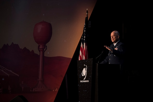 Gen. Jay Raymond, commander of Air Force Space Command and the Joint Force Space Component Command, speaks to an audience at the 35th Space Symposium in Colorado Springs, Colo., April 9, 2019.
