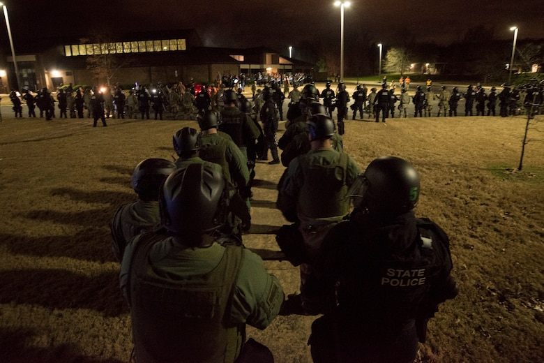 Arkansas National Guard and Arkansas State Police members form a crowd control line during Operation Phalanx, March 30-31, 2019, at Little Rock Air Force Base, Arkansas. The operation is a joint exercise hosted by the Arkansas National Guard for civilian and military organizations to train their members in tactics and techniques used in responding to a civil disturbance. (U.S. Air National Guard photo by Staff Sgt. Matthew Matlock)