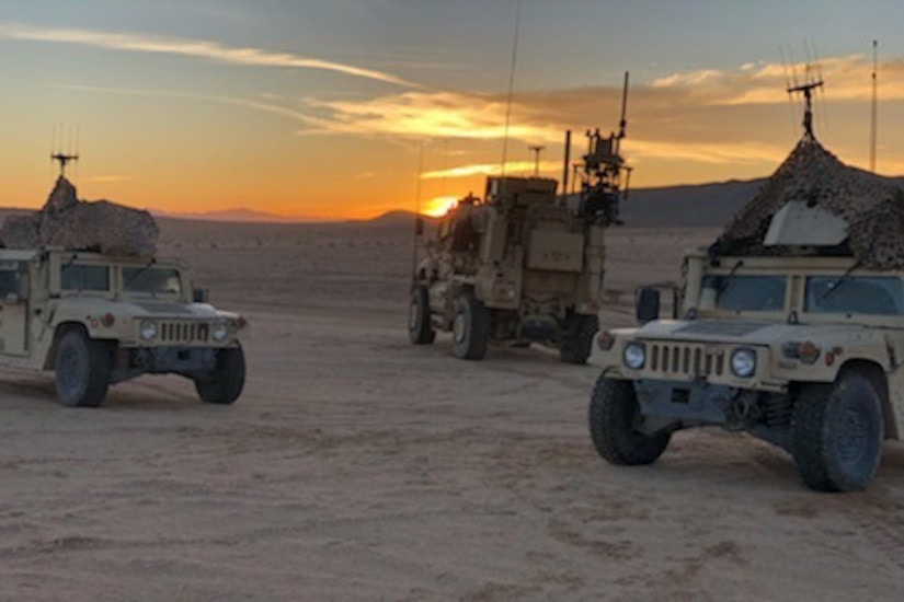 Military vehicles parked in desert