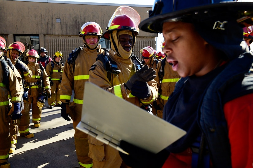 Sailor takes attendance at firefighting school.
