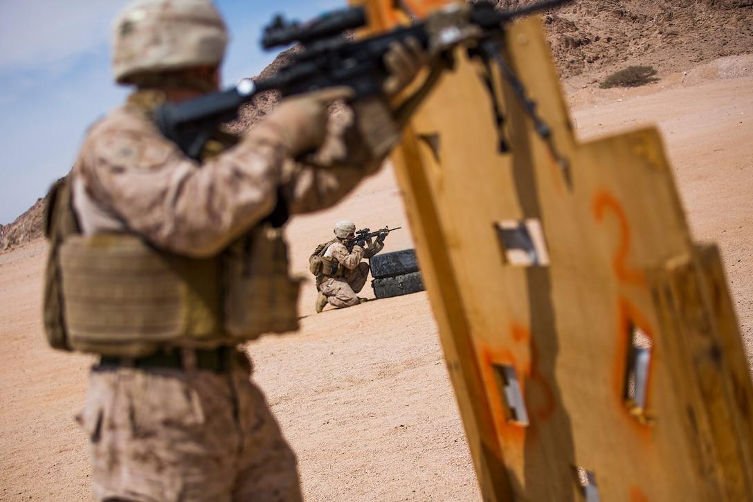 Marines conduct a fire team assault course.