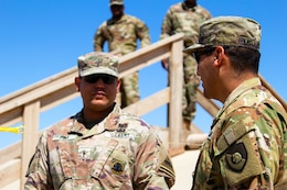 Warrant Officer Joseph Pina, 504th Quartermaster Company, 524th Support Battalion, 300th Sustainment Brigade, discusses fuel bag operations with Staff Sgt. Robert Miranda, 300th Sustainment Brigade fuel operation noncommissioned officer, at Camp Buehring, Kuwait, March 19, 2019.