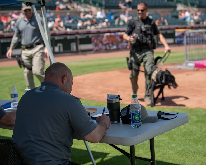 A panel of judges totals up a team's points after their run at the 2019 Desert Dog Trials, April 6, at Scottsdale Stadium, Scottsdale, Ariz.