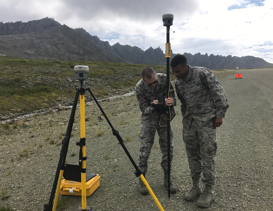U.S. Air Force Tech. Sgt. James Lawyer, 611th Civil Engineer Squadron airfield planning noncommissioned officer in charge, and Airman 1st Class Shane Leapheart, 673d CES engineer, set up a temporary base station at Cape Newnham, Alaska, August 2017. This procedure locates benchmarks on the site to establish vertical and horizontal coordinates for future projects and property surveying.