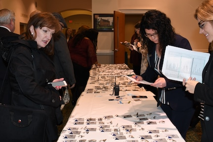 IMAGE: NSWCDD employees help attendees check-in at the 2019 NSWC Industry Fair held at the Fredericksburg Expo and Conference Center, March 21.
