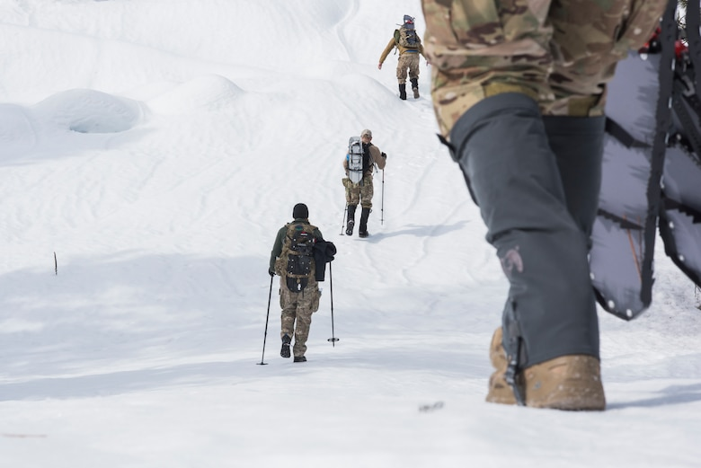 Photo of Idaho Air National Guard's 124th Tactical Air Control Party Hiking in the snow while participating in a lost hiker scenario training