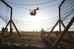 A Soldier with the Colorado National Guard tackles a rope traverse obstacle during the 2018 Best Warrior Competition April 15, 2018, at Fort Carson, Colorado. The Colorado Army National Guard winner advanced to the Region 7 Best Warrior Competition in New Mexico (U.S. Army National Guard photo by Spc. Ashley Low)