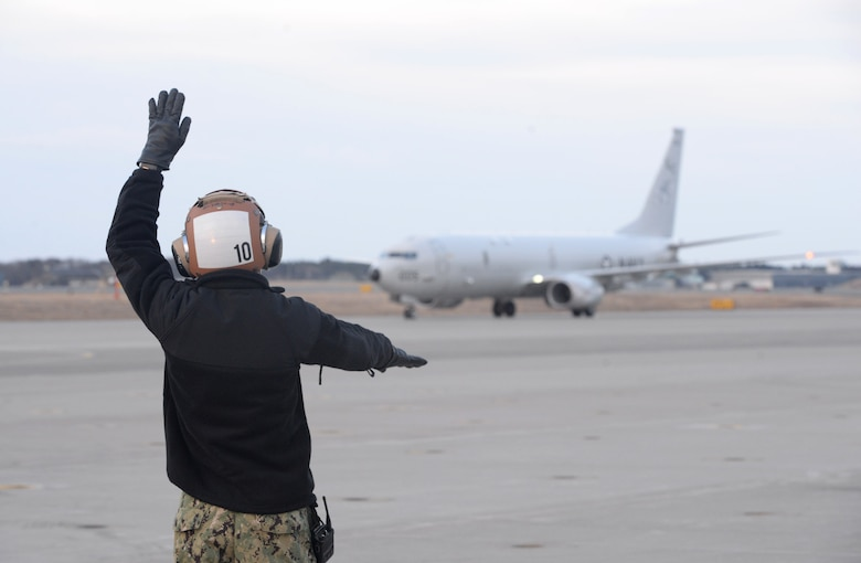 "MISAWA, Japan (April 10, 2019) Aviation Maintenance Administrationman Airman Roy Vega directs a P-8A Poseidon aircraft assigned to the ""Fighting Tigers"" of Patrol Squadron (VP) 8, on the flight line of Misawa Air Base after a Search and Rescue mission for a missing Japanese F-35 fighter jet Pilot. VP-8 is deployed to the U.S. 7th Fleet (C7F) area of operations conducting maritime patrol and reconnaissance operations in support of Commander, Task Force 72, C7F, and U.S. Pacific Command objectives throughout the Indo-Asia Pacific region."