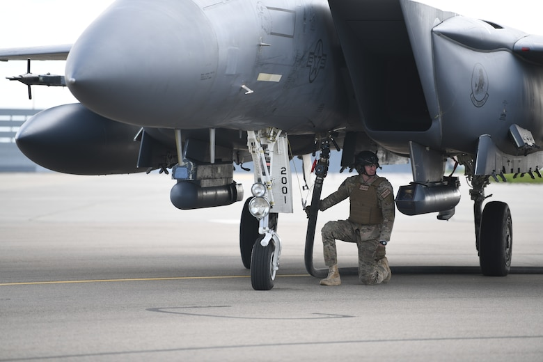 Airmen assigned to the 352nd Special Operations Wing perform Forward Arming and Refueling Point operations with an F-15E Strike Eagle assigned to 48th Fighter Wing April 10, 2019 at Royal Air Force Mildenhall, England. The FARP program is a United States Special Operations Command capability that allows the execution of refueling operations in situations where the use of conventional fueling stations or air-to-air refueling is unavailable. (U.S. Air Force photo/ Airman 1st Class Shanice Williams-Jones)