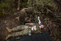 A U.S. Navy corpsman with Special Purpose Marine Air-Ground Task Force-Crisis Response-Africa 19.2, Marine Forces Europe and Africa, administers medical care to a simulated casualty during a Tactical Recovery of Aircraft and Personnel exercise in Troia, Portugal, April 5, 2019. SPMAGTF-CR-AF is deployed to conduct crisis-response and theater-security operations in Africa and promote regional stability by conducting military-to-military training exercises throughout Europe and Africa. (U.S. Marine Corps photo by Cpl. Margaret Gale)
