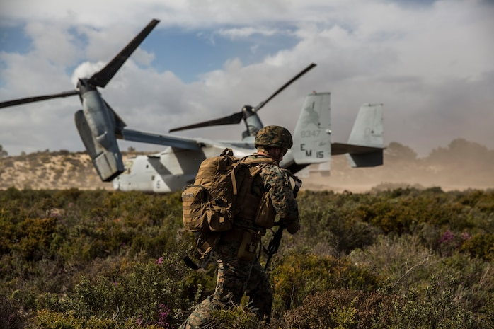 A U.S. Marine with Special Purpose Marine Air-Ground Task Force-Crisis Response-Africa 19.2, Marine Forces Europe and Africa, extracts from the landing zone on an MV-22B Osprey during a Tactical Recovery of Aircraft and Personnel exercise in Troia, Portugal, April 5, 2019. SPMAGTF-CR-AF is deployed to conduct crisis-response and theater-security operations in Africa and promote regional stability by conducting military-to-military training exercises throughout Europe and Africa. The aircraft is with SPMAGTF-CR-AF, Marine Forces Europe and Africa. (U.S. Marine Corps photo by Cpl. Margaret Gale)