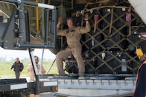 A U.S. Marine with Special Purpose Marine Air-Ground Task Force-Crisis Response-Africa prepares to unload cargo from a U.S. Marine KC-130J Super Hercules at Naval Air Station Sigonella, Italy, April 6, 2019. The aircraft transported Marines and equipment with the aviation combat element for SPMAGTF-CR-AF 19.2, whose mission is to provide an autonomous, self-deploying, and highly mobile crisis response force to U.S. AFRICOM. (U.S. Marine Corps photo by Staff Sgt. Mark E Morrow Jr)