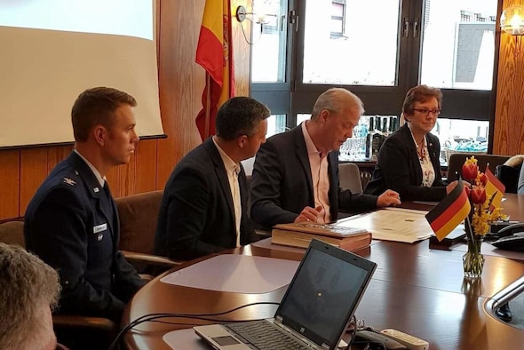 The mayors of Rota, Spain and Ramstein-Miesenbach, Germany signed a city partnership agreement at Ramstein-Miesenbach City Hall on April 8. U. S. Air Force Col. George Granholm, 521st Air Mobility Operations Wing vice commander, served as a witness for the agreement.
