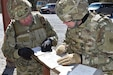 Col. David Chovancek and Brig. Gen. Aaron Walter prepare for the land navigation course.