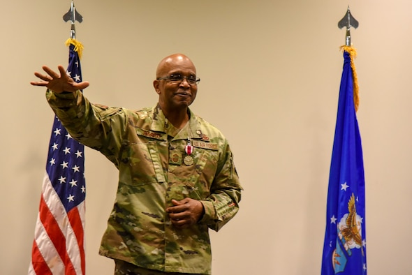 Chief Master Sgt. Marshall O. Harris Jr., 403rd Maintenance Group quality assurance superintendent, at Keesler Air Force Base, Miss., drops an invisible microphone on his retirement speech at Roberts Maintenance Facility April 6, 2019. After nearly three decades with the 403rd Wing, Harris will retire in June. (U.S. Air Force photo by Senior Airman Kristen Pittman)