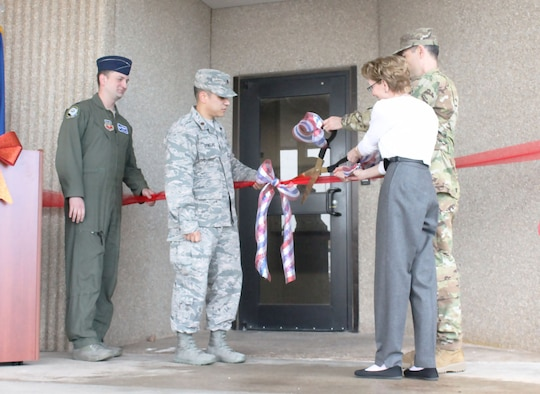 Key leaders from the 552nd Air Control Wing cut the ribbon, officially reopening the newly expanded Sensitive Compartmented Information Facility. Included in the ribbon-cutting were from left, Lt. Col. Adam Shelton, 552nd Operation Support Squadron commander; Maj. Eric Ornelas, 552nd OSS senior intelligence officer; Toni Greenfield, Chief, Special Security Office and Col. Geoffrey Weiss, 552nd ACW commander. (U.S. Air Force photo/2nd Lt. Ashlyn K. Paulson)