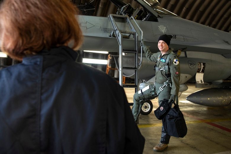 U.S. Air Force Lt. Col. Shaun Bellamy, 470th Air Base Squadron commander, right, speaks with Staff Sgt. Stephanie Gillie, 52nd Security Forces Squadron investigator, left, at Spangdahlem Air Base, Germany, April 3, 2019. Gillie, who had never been on a flightline before, volunteered to shadow a crew chief for a day to gain a better understanding of what maintainers do. Her day consisted of aircraft inspections, launching and recovering jets, and interacting with pilots. (U.S. Air Force photo by Airman 1st Class Valerie Seelye)