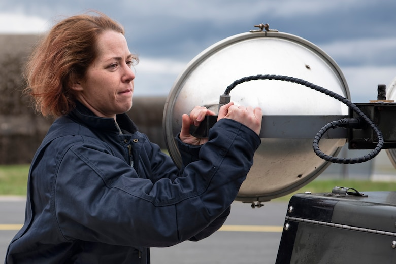U.S. Air Force Staff Sgt. Stephanie Gillie, 52nd Security Forces Squadron investigator, moves a light-all at Spangdahlem Air Base, Germany, April 3, 2019. Gillie volunteered to work on the flightline as part of the 52nd Aircraft Maintenance Squadron Crew Chief for a Day program. The program helps Airmen unfamiliar with flightline operations understand their tie to Spangdahlem's mission of airpower deterrence and readiness. (U.S. Air Force photo by Airman 1st Class Valerie Seelye)