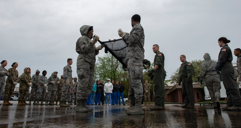 U.S. Airmen assigned to the 20th Medical Group lift a stretcher in a formation of four during a training exercise at Shaw Air Force Base, S.C., April 9, 2019.