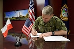 U.S. Navy Rear Adm. Richard Correll, U.S. Strategic Command (USSTRATCOM) director of plans and policy, signs an agreement to share space situational awareness (SSA) services and information with the Polish Space Agency at USSTRATCOM headquarters on Offutt Air Force Base, Neb., April 4, 2019. Correll signed the agreement as part of a larger effort to support spaceflight planning and enhance the safety, stability and sustainability of space operations. Poland joins 18 nations, two intergovernmental organizations, and 77 commercial satellite owners, operators, launchers already participating in SSA data-sharing agreements with USSTRATCOM.