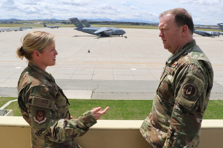 U.S. Air Force Col. Melissa Coburn, commander, 452nd Air Mobility Wing, March Air Reserve Base, discusses March ARB's capabilities and opportunities with U.S. Air Force Lt. Gen. Richard Scobee, commander, Air Force Reserve Command, while overlooking the flight line at wing headquarters building here April 5, 2019. AFRC senior leadership toured March ARB to learn about the 452nd AMW's mission, capabilities and challenges as part of a three-day unit visit.
