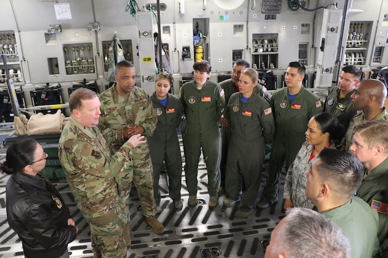 U.S. Air Force Lt. Gen. Richard Scobee, commander of Air Force Reserve Command, and U.S. Air Force Chief Master Sgt. Timothy White, AFRC command chief, speak with members from the 452nd Aeromedical Evacuation Squadron aboard a C-17 Globemaster III on the flight line here April 6, 2019. AFRC senior leadership toured March ARB to learn about the 452nd AMW's mission, capabilities and challenges as part of a three-day unit visit.