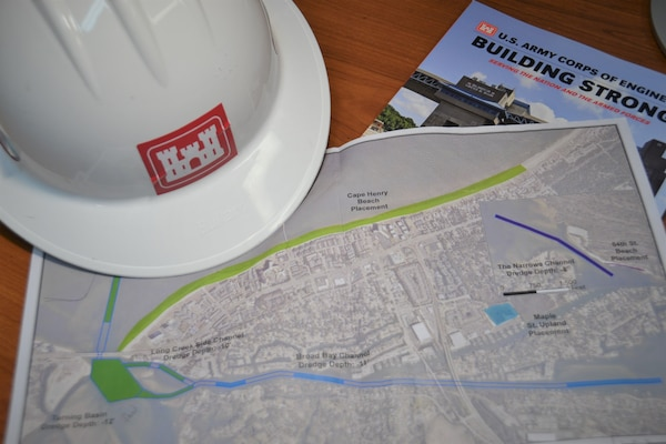 A map of proposed work for the Lynnhaven Inlet Federal Navigation Project for the City of Virginia Beach is flanked by a U.S. Army Corps of Engineers hard hat and USCAE literature on a desk at Fort Norfolk, Virginia, April 8, 2019