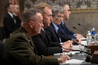 Men sit before Senate microphones.