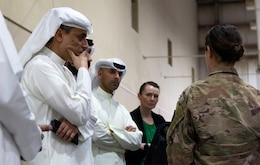 1st Lt. Stephanie Palamas, 502th Human Resource Company, 300th Sustainment Brigade, discusses operations at the Joint Military Mail Terminal with the Kuwait Criminal Investigation Division at Camp Arifjan, Kuwait, March 7, 2019.