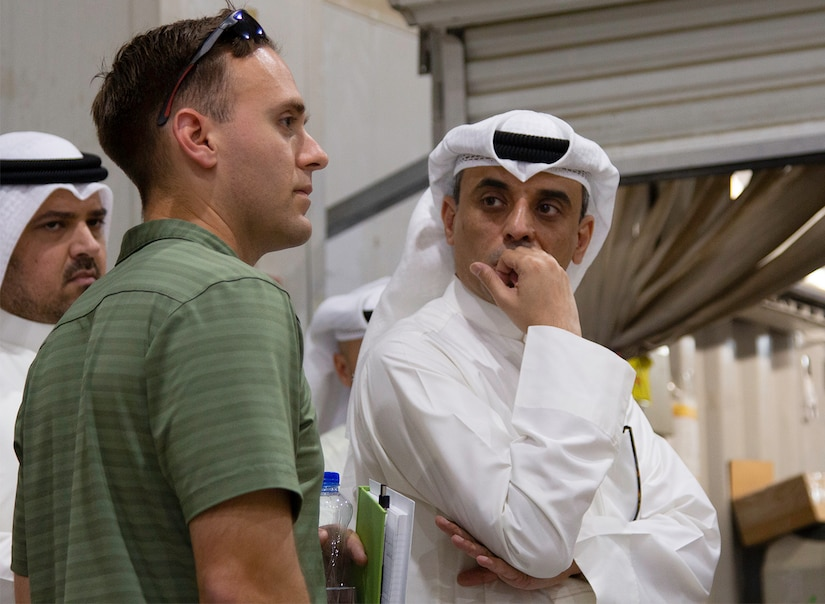 A Soldier from the U.S. Army Criminal Investigation Division asks a question regarding operations at the Joint Military Mail Terminal at Camp Arifjan, Kuwait, March 7, 2019.