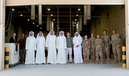 300th Sustainment Brigade Soldiers stand with members of the Kuwait Criminal Investigation Division during a tour of the Joint Military Mail Terminal at Camp Arifjan, Kuwait, March 7, 2019.