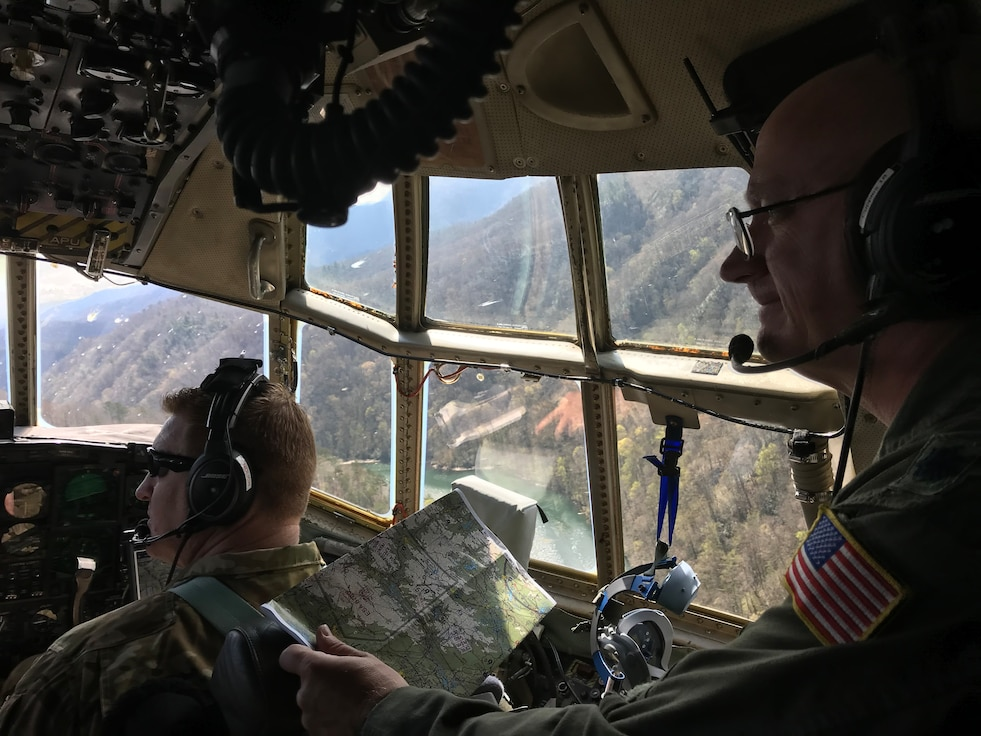 "Lt. Col. Barry ""JR"" Cupples, a navigator with the 757th Airlift Squadron, looks through the flight deck windows of a C-130H Hercules aircraft during the flight in which he completed his ten thousandth C-130 flight hour, April 6, 2019."