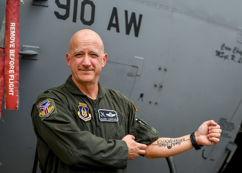 "Lt. Col. Barry ""JR"" Cupples, a navigator with the 757th Airlift Squadron, shows a new tattoo commemorating his ten thousandth C-130 flight hour following the milestone sortie here, April 6, 2019."