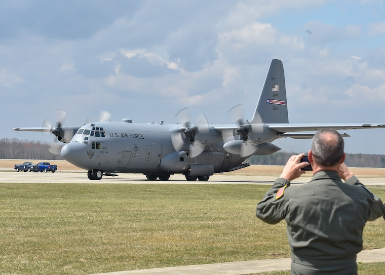 A Reserve Citizen Airman assigned to the 757th Airlift Squadron watches a C-130H Hercules aircraft taxi to its parking spot here, April 6, 2019.