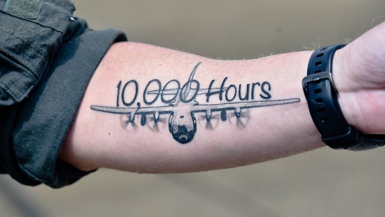 "Lt. Col. Barry ""JR"" Cupples, a navigator assigned to the 757th Airlift Squadron here, displays a new tattoo on his forearm after completing his ten thousandth C-130 flight hour here, April 6, 2019."