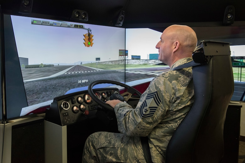 U.S. Air Force Chief Master Sgt. Jeffrey Ruckman, 673d Civil Engineer Squadron superintendent, tests the 773d Logistics Readiness Squadron ground transportation section's new driving simulator at Joint Base Elmendorf-Richardson, Alaska, April 5, 2019. The interactive simulator allows drivers to interact with computer-generated vehicles in a realistic environment.