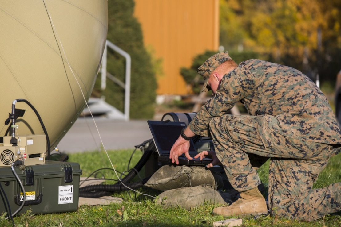 U.S. Marine Corps Lance Cpl. Jeffrey Washburn, with 2nd Radio Battalion, II Marine Expeditionary Force Information Group sets up an Odin's Sphere in order to have satellite communications during Exercise Trident Juncture 2018 at Vaernes Air Station, Norway, Oct. 12, 2018. Trident Juncture 2018 enhances the U.S. and NATO Allies' and partners' abilities to work together collectively to conduct military operations under challenging conditions. (U.S. Marine Corps photo by Lance Cpl. Tanner Seims)
