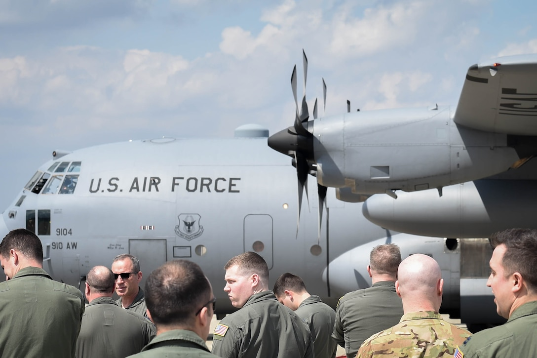 "A crowd of aircrew members from the 757th Airlift Squadron wait for Lt. Col. Barry ""JR"" Cupples, a 757th AS navigator, to step off of a C-130H Hercules aircraft here, April 6, 2019."
