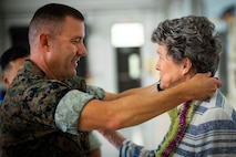 U.S. Marine Corps Lt. Col. Brian Clifton, left, commanding officer, Marine Medium Tiltrotor Squadron (VMM) 363, presents Cynthia Thielen, right, Hawaii State Representative, with a lei during VMM 363's hangar dedication ceremony, Marine Corps Air Station Kaneohe Bay, Marine Corps Base Hawaii, Sept. 21, 2018.