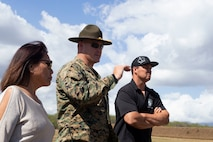 U.S. Marine Corps Chief Warrant Officer 2 Jeffrey Wright, center, officer in charge of Pu'uloa Range Training Facility, leads a tour of the grounds for Rep. Rida Arakawa, left, of Hawaii's Ewa District and Mitchell Tynanes, right, Ewa Neighborhood Board Chair, Marine Corps Base Hawaii (MCBH), Apr. 8, 2019.