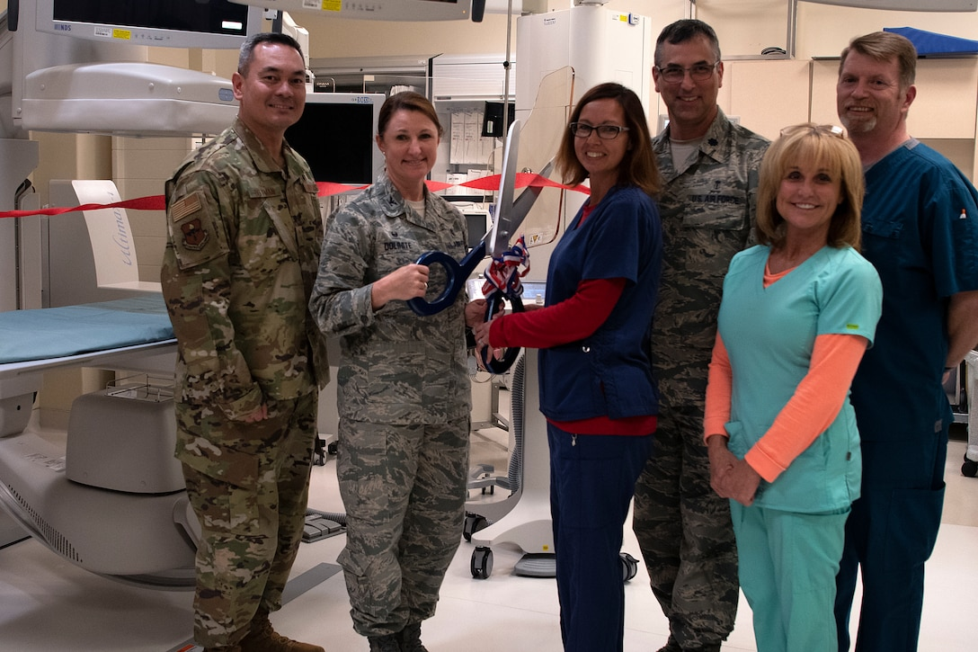 U.S. Air Force Col. Beatrice Dolihite, 81st Medical Group commander, and 81st MDG personnel participate in a ribbon cutting ceremony inside Keesler Medical Center on Keesler Air Force Base, Mississippi, April 10, 2019. The Radiology Oncology Clinic received a Positron Emission Tomography and Computer Tomography scanner as well as an Interventional Radiology Program, which will improve patient care. (U.S. Air Force photo by Senior Airman Suzie Plotnikov)
