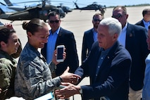 U.S. Vice President Mike Pence greets the Desert Lightning Team during a quick visit with the DLT prior to his immersion with Customs and Border Protection at Davis-Monthan Air Force Base, Ariz., April 11, 2019.