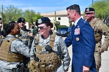 U.S Air Force Col. Mike Drowley, 355th Wing commander, greet 355th Security Forces defenders at Davis-Monthan Air Force Base, Ariz., April 11, 2019.